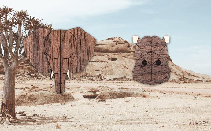 Drevené brošne slon a hroch na obrázku africkej prírody